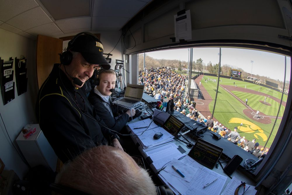 Henry B. and Patricia B. Tippie Director of Athletics Chair Gary Barta talks on the radio as the Iowa Hawkeyes face off against Michigan Saturday, April 28, 2018 at Duane Banks Field (Brian Ray/hawkeyesports.com)