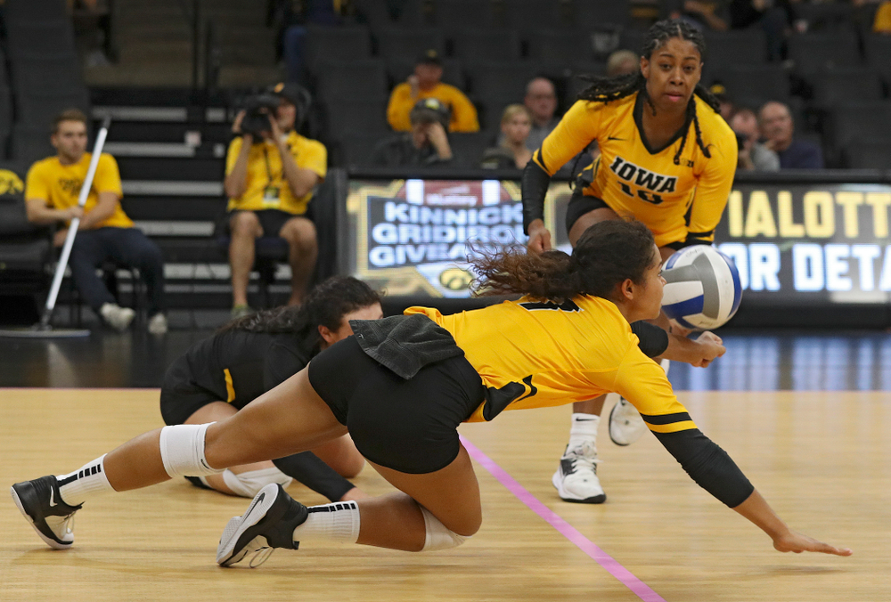 Iowa's Brie Orr (7) dives for a dig during their match at Carver-Hawkeye Arena in Iowa City on Sunday, Oct 20, 2019. (Stephen Mally/hawkeyesports.com)
