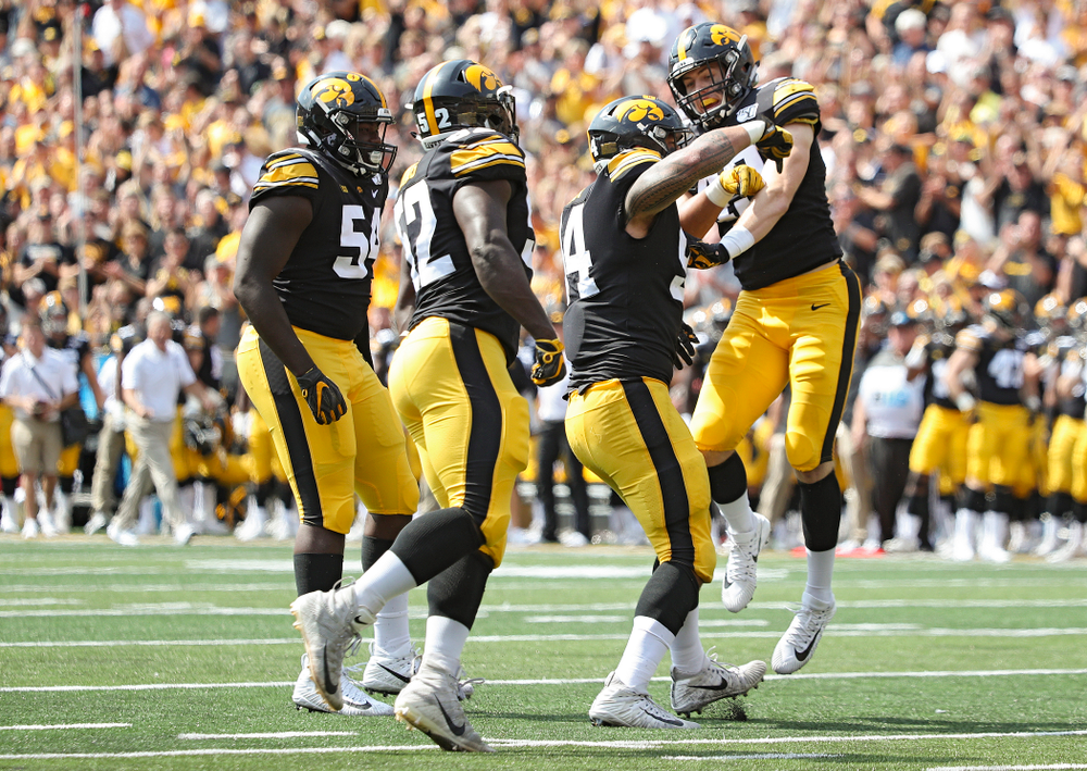 Iowa Hawkeyes defensive tackle Daviyon Nixon (54), linebacker Amani Jones (52), defensive end A.J. Epenesa (94), and linebacker Nick Niemann (49) celebrate after a sack during the second quarter of their Big Ten Conference football game at Kinnick Stadium in Iowa City on Saturday, Sep 7, 2019. (Stephen Mally/hawkeyesports.com)