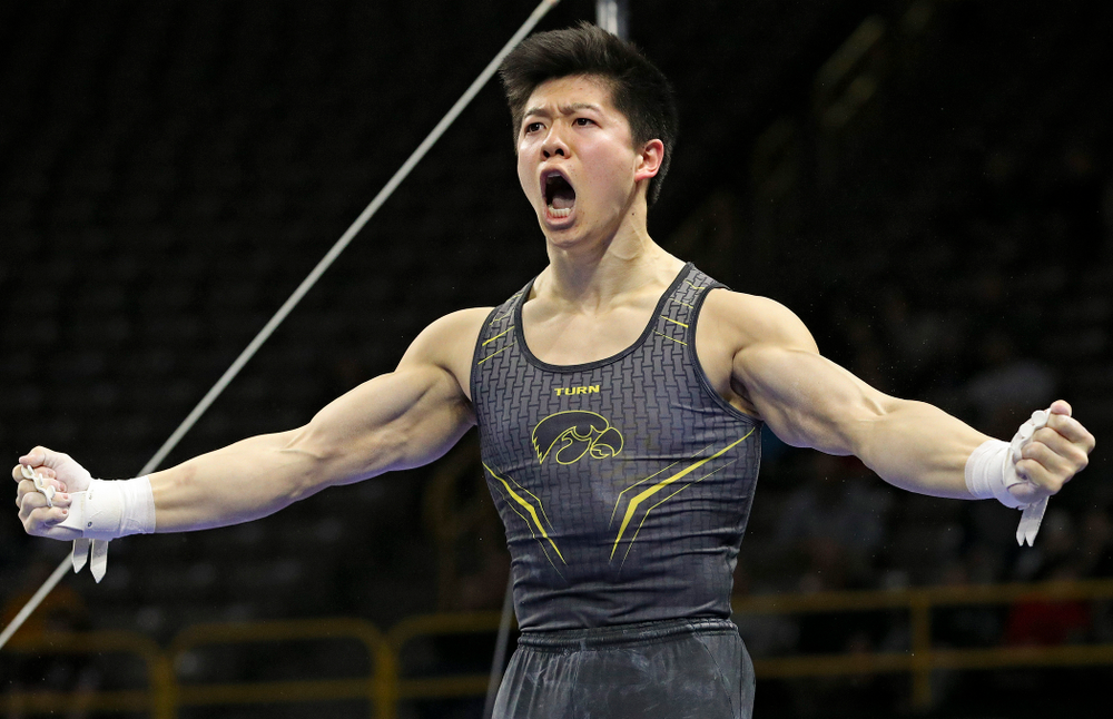 Iowa's Bennet Huang is pumped up after competing in the horizontal bar during the first day of the Big Ten Men's Gymnastics Championships at Carver-Hawkeye Arena in Iowa City on Friday, Apr. 5, 2019. (Stephen Mally/hawkeyesports.com)