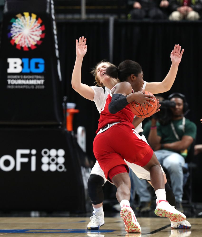 Iowa Hawkeyes guard Kathleen Doyle (22) draws a charging foul against the Indiana Hoosiers in the quarterfinals of the Big Ten Tournament Friday, March 8, 2019 at Bankers Life Fieldhouse in Indianapolis, Ind. (Brian Ray/hawkeyesports.com)