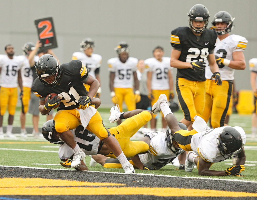 Iowa Hawkeyes running back Ivory Kelly-Martin (21) powers his way into the end zone durning Fall Camp Practice No. 17 at the Hansen Football Performance Center in Iowa City on Wednesday, Aug 21, 2019. (Stephen Mally/hawkeyesports.com)