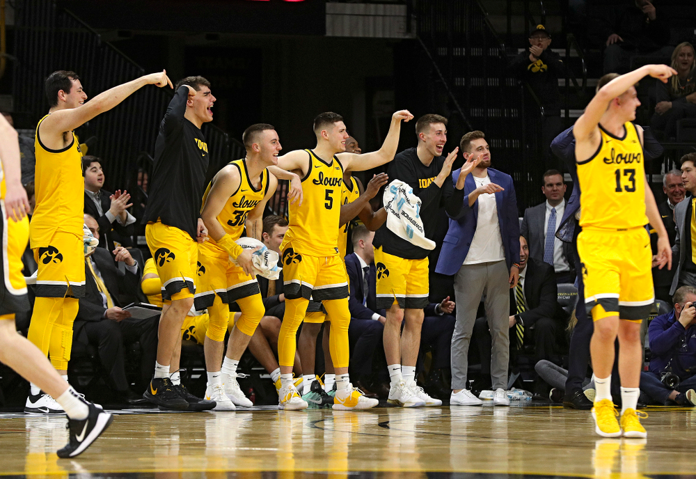 Iowa Hawkeyes forward Ryan Kriener (15), center Luka Garza (55), guard Connor McCaffery (30), guard CJ Fredrick (5), guard Joe Wieskamp (10), an guard Jordan Bohannon (3) celebrate a goaltending call on Nebraska Cornhuskers during the second half of their game at Carver-Hawkeye Arena in Iowa City on Saturday, February 8, 2020. (Stephen Mally/hawkeyesports.com)