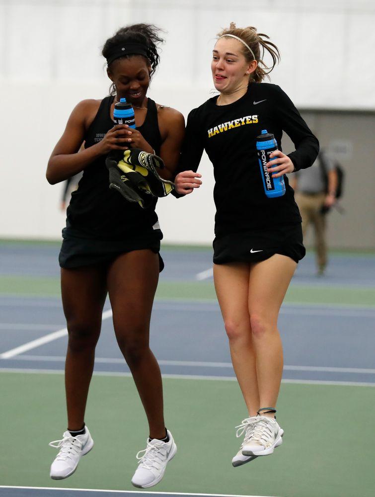 Iowa's Adorabol Huckleby and Zoe Douglas celebrate their win over Marquette