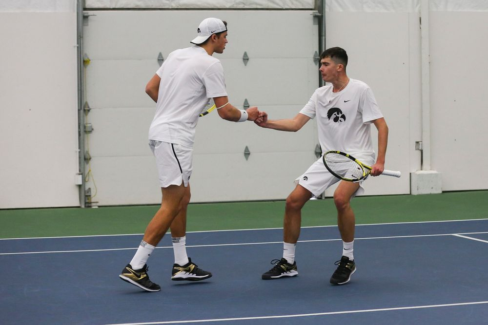 Iowa's Joe Tyler and Matt Clegg celebrate a point during the Iowa men's tennis match vs Western Michigan on Saturday, January 18, 2020 at the Hawkeye Tennis and Recreation Complex. (Lily Smith/hawkeyesports.com)