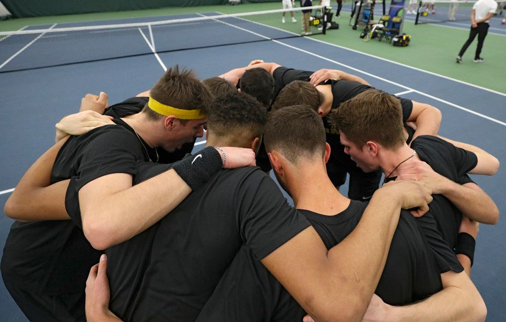 The Hawkeyes huddle before their match at the Hawkeye Tennis and Recreation Complex in Iowa City on Thursday, January 16, 2020. (Stephen Mally/hawkeyesports.com)