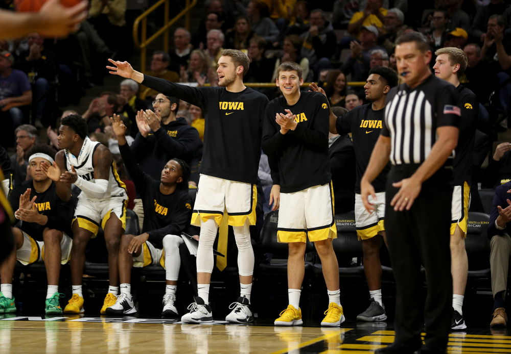 Iowa Hawkeyes forward Riley Till (20) and guard Austin Ash (13) celebrate a three point basket against the Minnesota Golden Gophers Monday, December 9, 2019 at Carver-Hawkeye Arena. (Brian Ray/hawkeyesports.com)