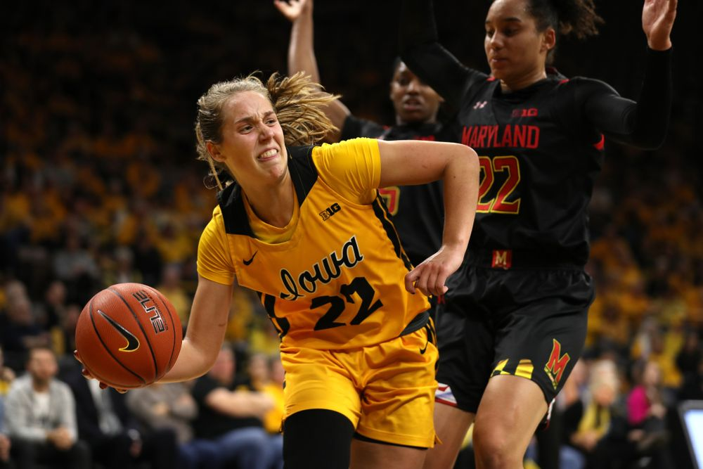 Iowa Hawkeyes guard Kathleen Doyle (22) dishes off a pass Against the Maryland Terrapins Thursday, January 9, 2020 at Carver-Hawkeye Arena. (Brian Ray/hawkeyesports.com)