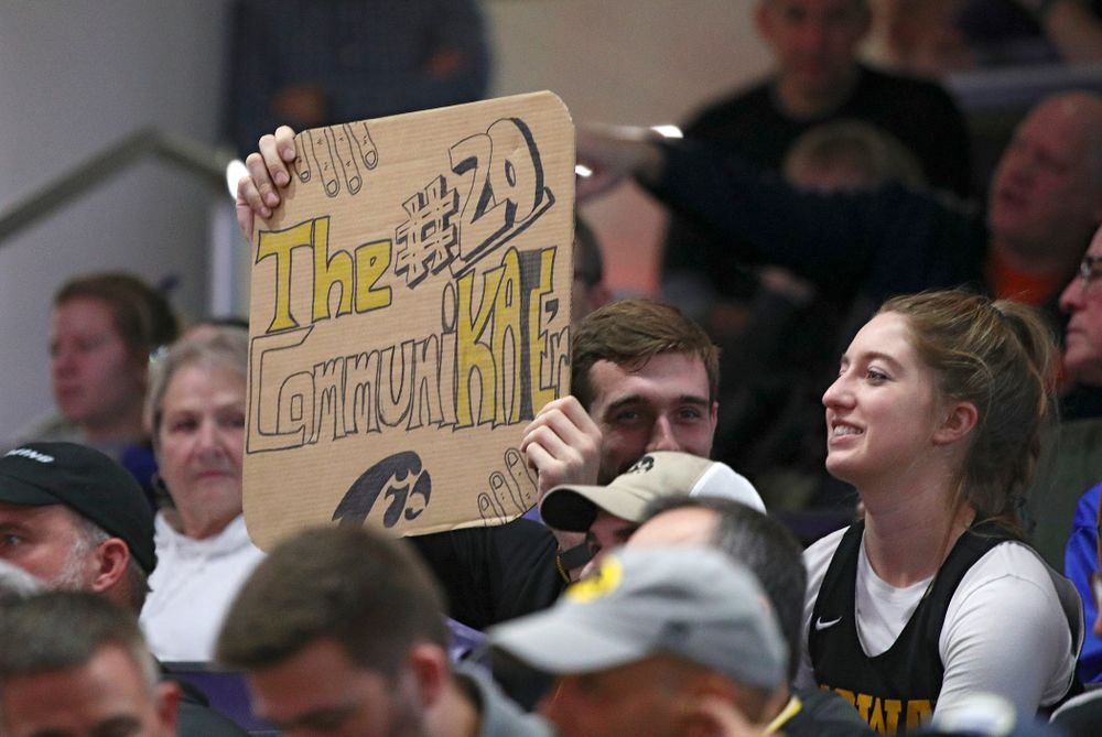 Fans hold up a sign for Iowa Hawkeyes guard Kate Martin during the fourth quarter of their game at Welsh-Ryan Arena in Evanston, Ill. on Sunday, January 5, 2020. (Stephen Mally/hawkeyesports.com)