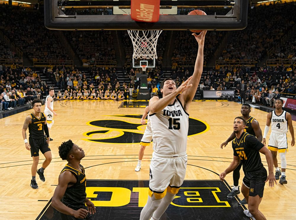 Iowa Hawkeyes forward Ryan Kriener (15) scores inside during the second half of their their game at Carver-Hawkeye Arena in Iowa City on Sunday, December 29, 2019. (Stephen Mally/hawkeyesports.com)