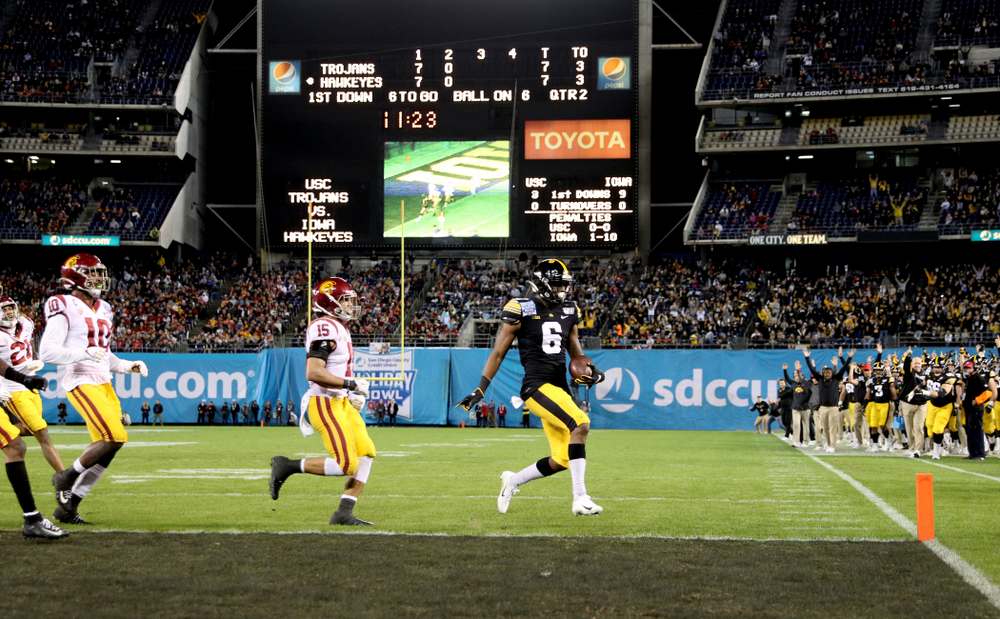 Iowa Hawkeyes wide receiver Ihmir Smith-Marsette (6) scores a touchdown against USC in the Holiday Bowl Friday, December 27, 2019 at San Diego Community Credit Union Stadium.  (Brian Ray/hawkeyesports.com)