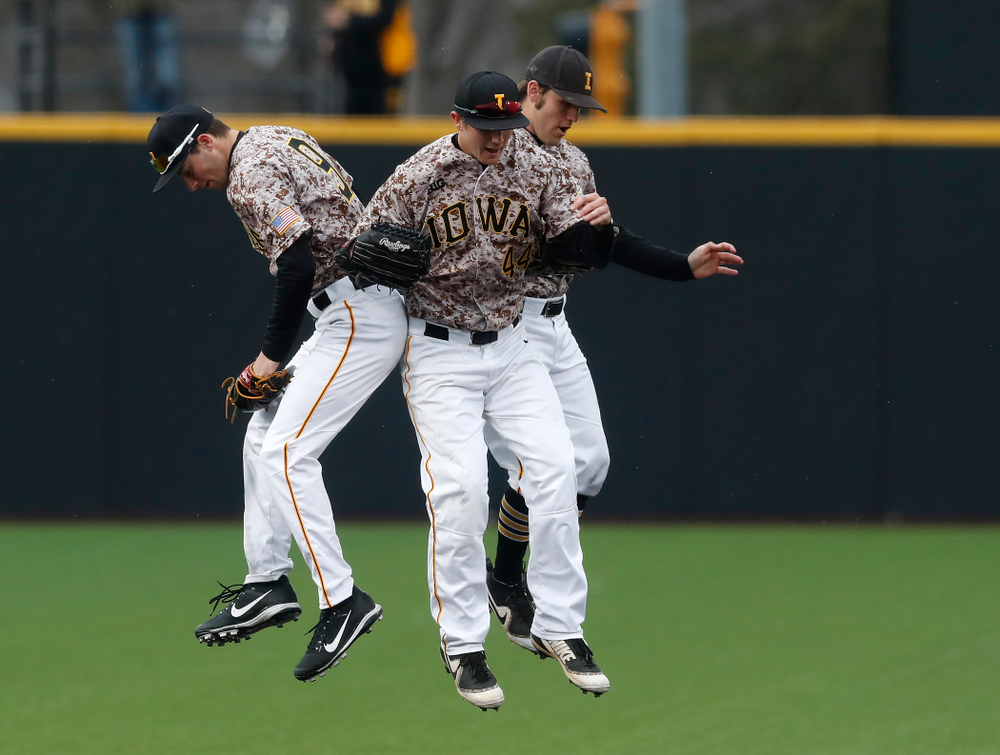 Iowa Hawkeyes outfielder Ben Norman (9), outfielder Robert Neustrom (44), and outfielder Justin Jenkins (6) during a double header against the Indiana Hoosiers Friday, March 23, 2018 at Duane Banks Field. (Brian Ray/hawkeyesports.com)