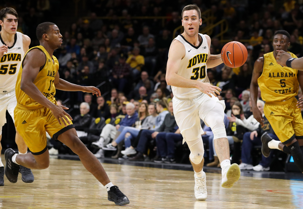 Iowa Hawkeyes guard Connor McCaffery (30) dribbles the ball during a game against Alabama State at Carver-Hawkeye Arena on November 21, 2018. (Tork Mason/hawkeyesports.com)