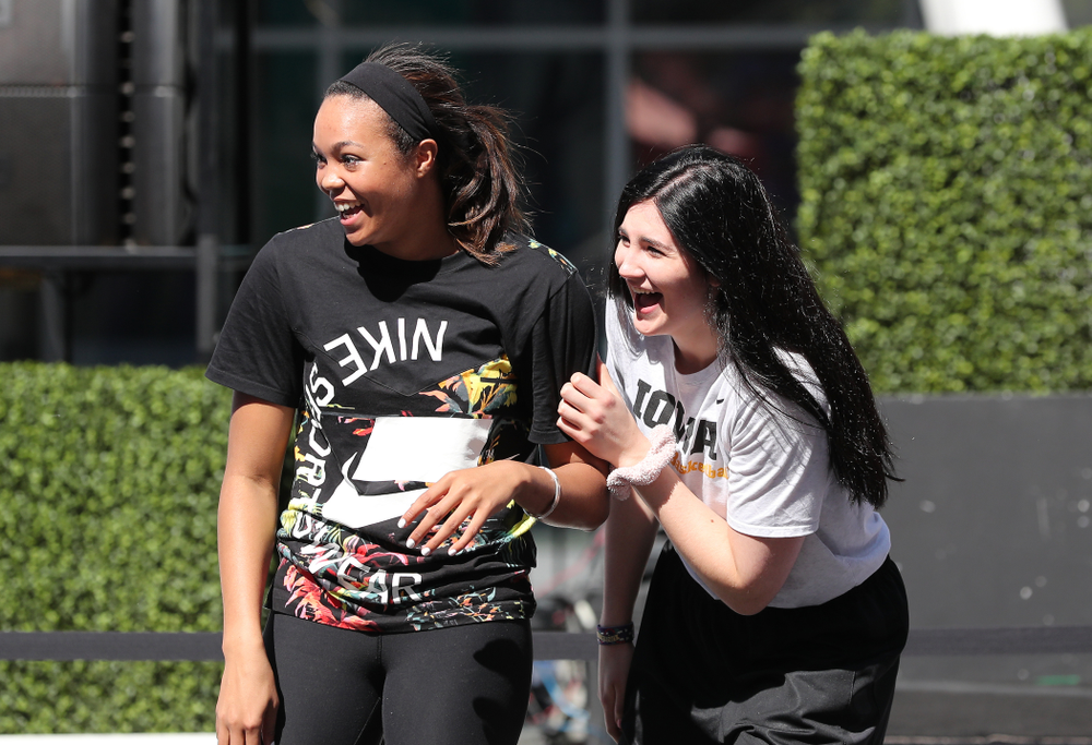 Iowa Hawkeyes forward Megan Gustafson (10) and UCONNÕs Napheesa Collier during a Special Olympics event Friday, April 12, 2019 as part of the ESPN College Basketball Awards in the XBOX Plaza at LA Live.  (Brian Ray/hawkeyesports.com)