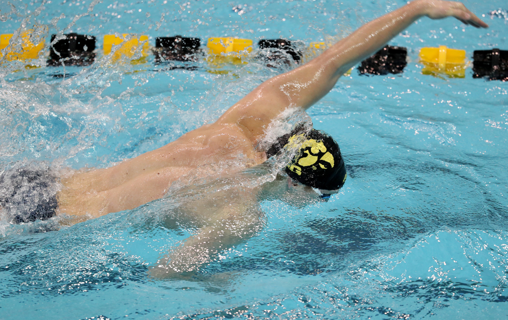 IowaÕs Joe Myhre swims the freestyle leg of the 200 Medley Relay against Notre Dame and Illinois Saturday, January 11, 2020 at the Campus Recreation and Wellness Center.  (Brian Ray/hawkeyesports.com)