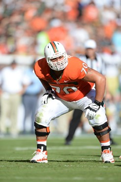 University of Miami Hurricanes offensive lineman Jonathan Feliciano #70 plays in a game against the Georgia Tech Yellow Jackets at Sun Life Stadium on...