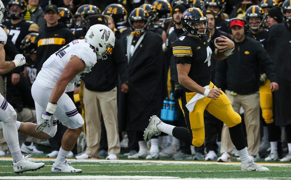 Iowa Hawkeyes quarterback Nate Stanley (4) runs the ball during a game against Northwestern at Kinnick Stadium on November 10, 2018. (Tork Mason/hawkeyesports.com)