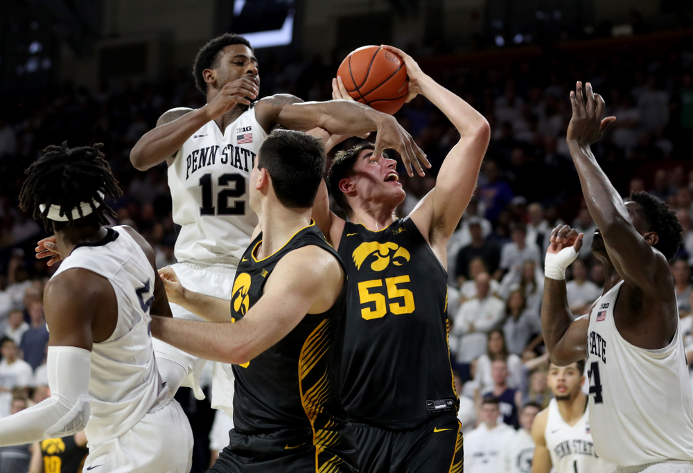 Iowa Hawkeyes forward Luka Garza (55) draws a foul against Penn State Saturday, January 4, 2020 at the Palestra in Philadelphia. (Brian Ray/hawkeyesports.com)