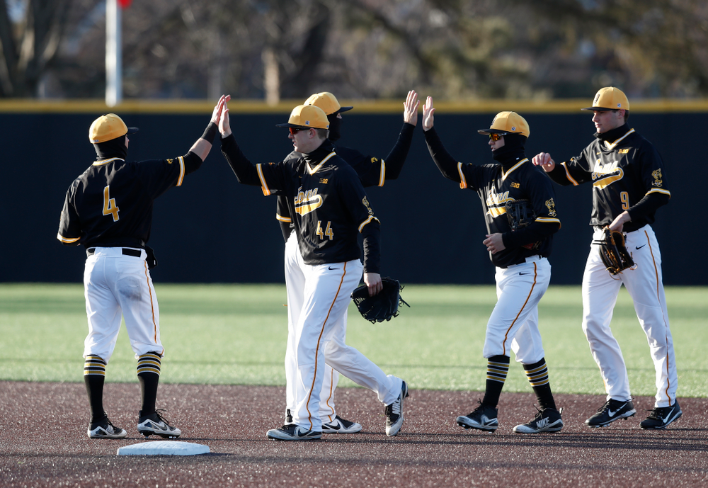 Iowa Hawkeyes infielder Mitchell Boe (4) and outfielder Robert Neustrom (44) against Grand View Wednesday, April 4, 2018 at Duane Banks Field. (Brian Ray/hawkeyesports.com)