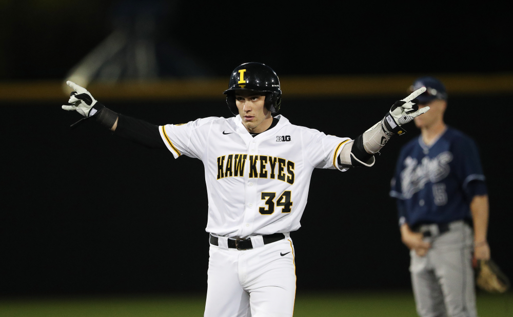 Iowa Hawkeyes catcher Austin Martin (34) doubles to drive in a run during game one against UC Irvine Friday, May 3, 2019 at Duane Banks Field. (Brian Ray/hawkeyesports.com)