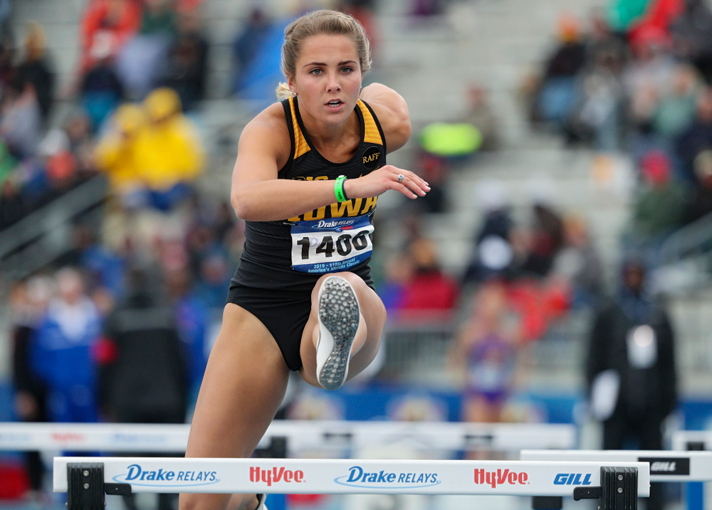 Iowa's Addie Swanson runs the women's shuttle hurdles event during the third day of the Drake Relays at Drake Stadium in Des Moines on Saturday, Apr. 27, 2019. (Stephen Mally/hawkeyesports.com)