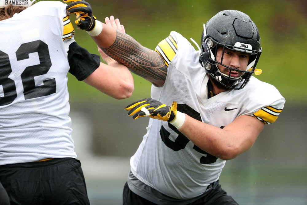 Iowa Hawkeyes defensive end A.J. Epenesa (94) works a drill during practice Monday, December 23, 2019 at Mesa College in San Diego. (Brian Ray/hawkeyesports.com)