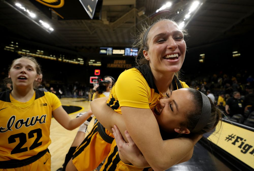 Iowa Hawkeyes guard Makenzie Meyer (3) and guard Gabbie Marshall (24) during senior day activities following their win over the Minnesota Golden Gophers Thursday, February 27, 2020 at Carver-Hawkeye Arena. (Brian Ray/hawkeyesports.com)