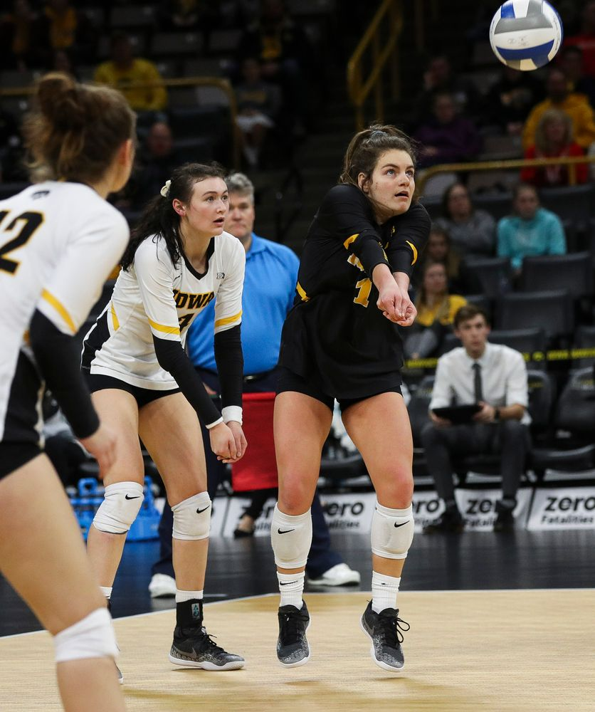 Iowa Hawkeyes defensive specialist Molly Kelly (1) bumps the ball during a match against Maryland at Carver-Hawkeye Arena on November 23, 2018. (Tork Mason/hawkeyesports.com)