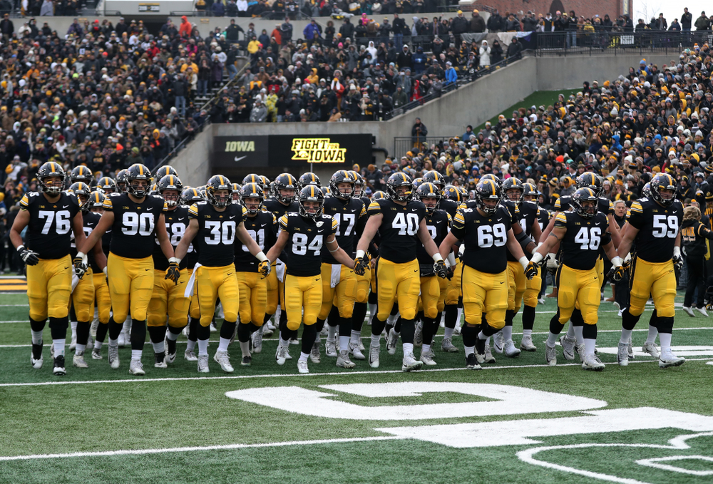 The Iowa Hawkeyes swarm onto the field for their game against the Northwestern Wildcats Saturday, November 10, 2018 at Kinnick Stadium. (Brian Ray/hawkeyesports.com)