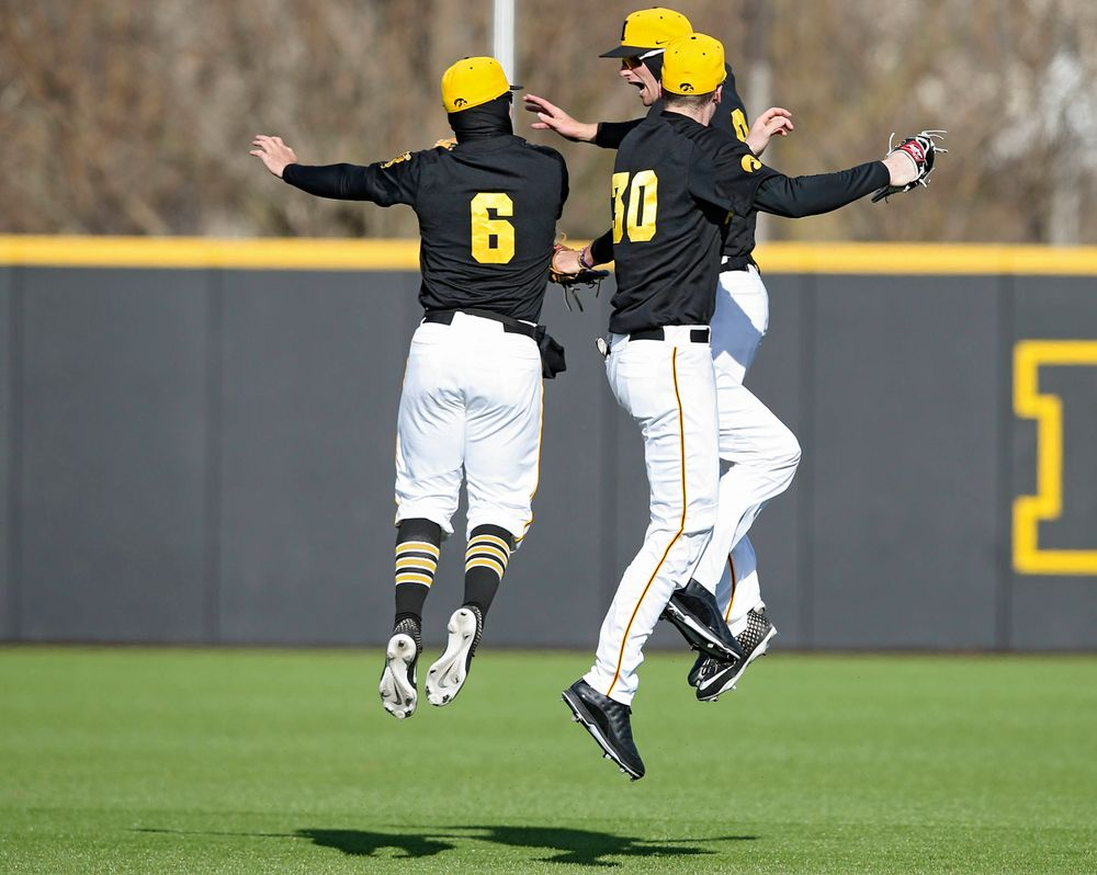 Iowa Hawkeyes center fielder Justin Jenkins (6) right fielder Ben Norman (9), and left fielder Connor McCaffery (30) celebrate after winning their game against Illinois at Duane Banks Field in Iowa City on Saturday, Mar. 30, 2019. (Stephen Mally/hawkeyesports.com)