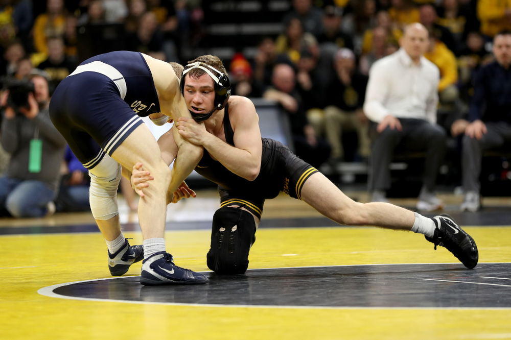 Iowa's Spencer Lee wrestles Penn State's Brandon Meredith at 125 pounds Friday, January 31, 2020 at Carver-Hawkeye Arena.Lee won the match by technical fall. (Brian Ray/hawkeyesports.com)