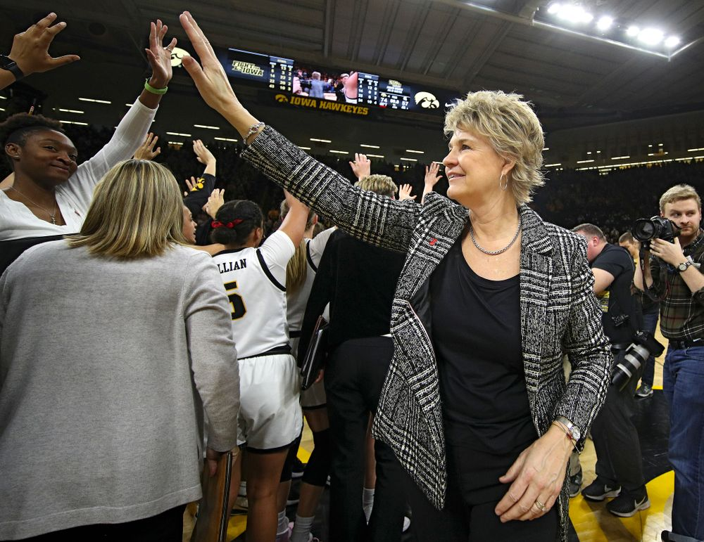 Iowa Hawkeyes head coach Lisa Bluder waves to the fans after winning their game at Carver-Hawkeye Arena in Iowa City on Sunday, January 26, 2020. (Stephen Mally/hawkeyesports.com)