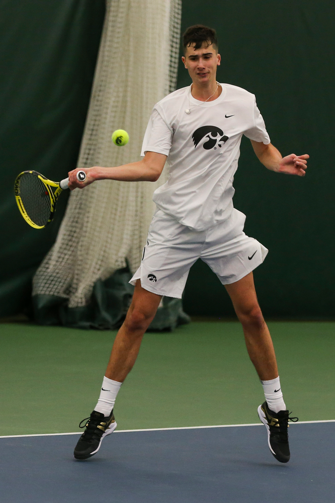 Iowa's Matt Clegg hits a forehand during the Iowa men's tennis match vs Western Michigan on Saturday, January 18, 2020 at the Hawkeye Tennis and Recreation Complex. (Lily Smith/hawkeyesports.com)