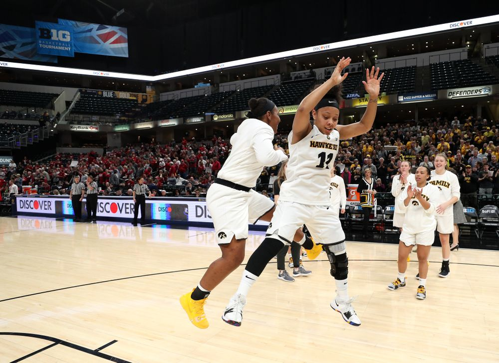 Iowa Hawkeyes guard Tania Davis (11) and guard Zion Sanders (24) against the Indiana Hoosiers in the quarterfinals of the Big Ten Tournament Friday, March 8, 2019 at Bankers Life Fieldhouse in Indianapolis, Ind. (Brian Ray/hawkeyesports.com)