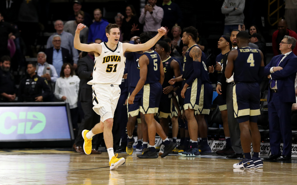 Iowa Hawkeyes forward Nicholas Baer (51) celebrates their victory against the Pitt Panthers Tuesday, November 27, 2018 at Carver-Hawkeye Arena. (Brian Ray/hawkeyesports.com)
