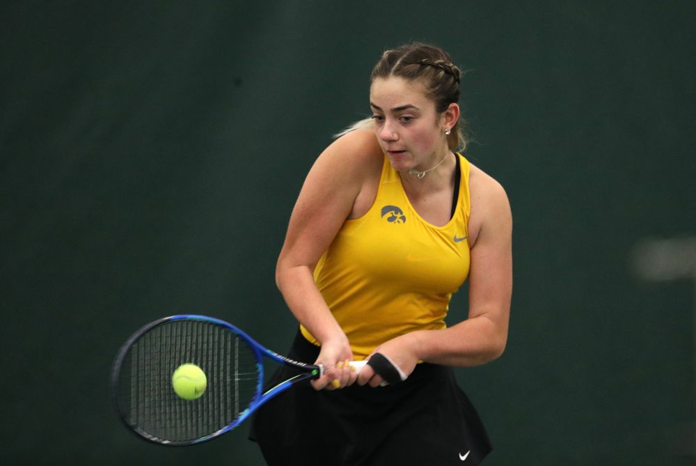 Iowa's Sophie Clark plays a doubles match against Xavier Friday, January 18, 2019 at the Hawkeye Tennis and Recreation Center. (Brian Ray/hawkeyesports.com)