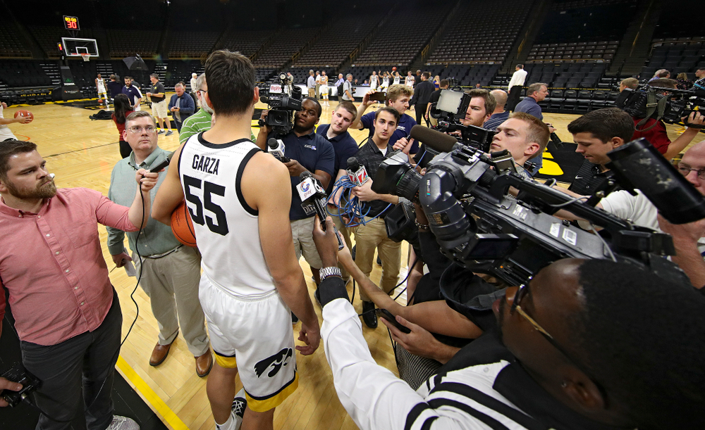Iowa Hawkeyes forward Luka Garza (55) answers questions during Iowa Men's Basketball Media Day at Carver-Hawkeye Arena in Iowa City on Wednesday, Oct 9, 2019. (Stephen Mally/hawkeyesports.com)