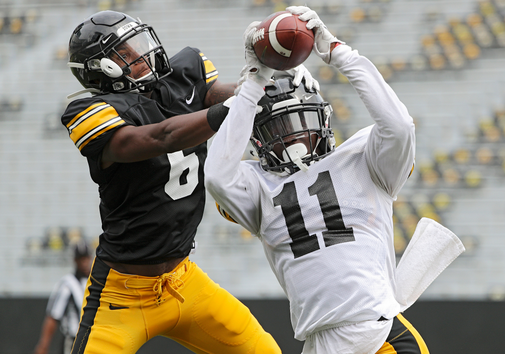 Iowa Hawkeyes defensive back Michael Ojemudia (11) intercepts a pass intended for wide receiver Ihmir Smith-Marsette (6) during Fall Camp Practice No. 8 at Kids Day at Kinnick Stadium in Iowa City on Saturday, Aug 10, 2019. (Stephen Mally/hawkeyesports.com)
