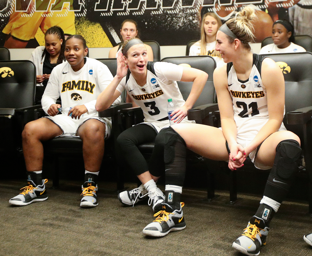 Iowa Hawkeyes guard Makenzie Meyer (3) motions as she talks about how loud the crowd was as she sits with her team in the locker room after winning their second round game in the 2019 NCAA Women's Basketball Tournament at Carver Hawkeye Arena in Iowa City on Sunday, Mar. 24, 2019. (Stephen Mally for hawkeyesports.com)