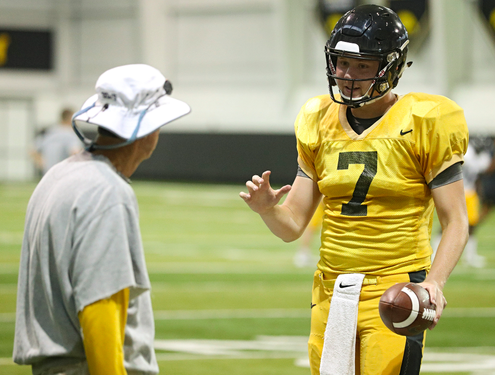 Iowa Hawkeyes quarterback Spencer Petras (7) talks with quarterbacks coach Ken O'Keefe during Fall Camp Practice No. 6 at the Hansen Football Performance Center in Iowa City on Thursday, Aug 8, 2019. (Stephen Mally/hawkeyesports.com)