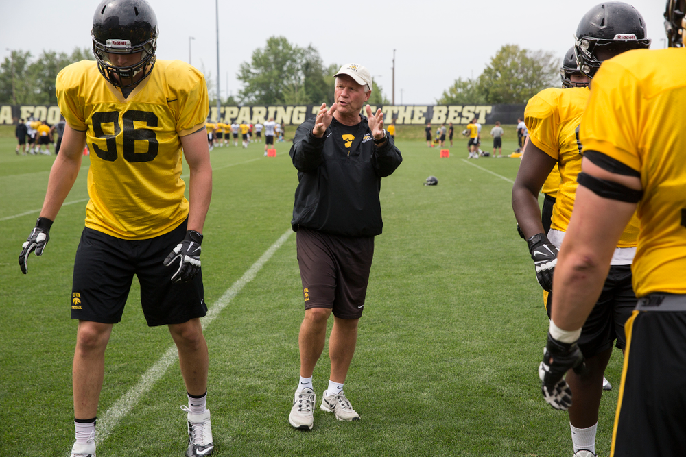 Iowa Hawkeyes Defensive Line coach Reese Morgan works with his unit during the team's eighth practice of camp Sunday, Aug. 10, 2014 at the Hayden Fry Football Complex in Iowa City.  (Brian Ray/hawkeyesports.com)