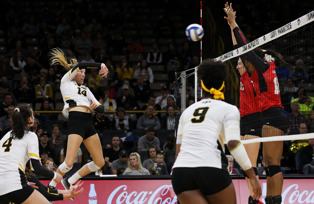 Iowa Hawkeyes outside hitter Cali Hoye (14) spikes the ball during a match against Rutgers at Carver-Hawkeye Arena on November 2, 2018. (Tork Mason/hawkeyesports.com)