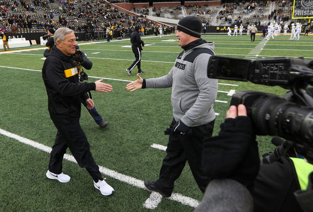 Iowa Hawkeyes head coach Kirk Ferentz shakes hands with Northwestern Wildcats head coach Pat Fitzgerald before a game against Northwestern at Kinnick Stadium on November 10, 2018. (Tork Mason/hawkeyesports.com)