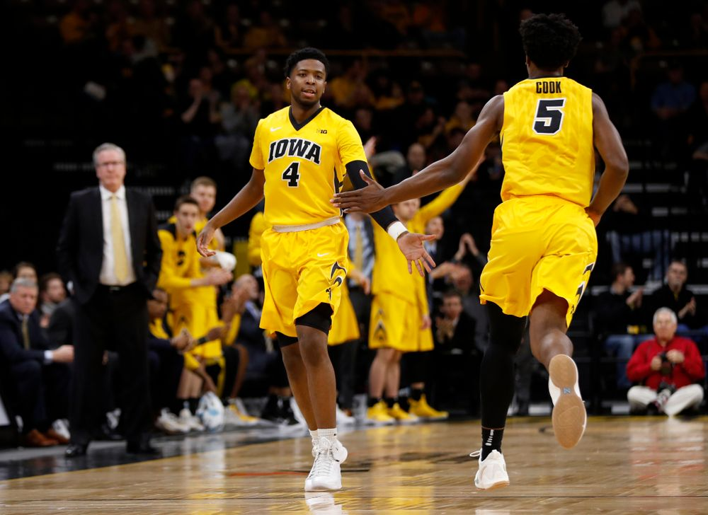 Iowa Hawkeyes guard Isaiah Moss (4) and forward Tyler Cook (5)