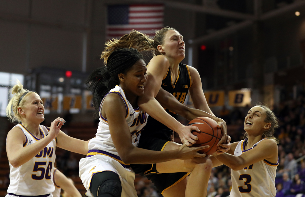 Iowa Hawkeyes forward Amanda Ollinger (43) battles for a rebound against Northern IowaÕs Bre Gunnels (11) Sunday, November 17, 2019 at the McLeod Center. (Brian Ray/hawkeyesports.com)