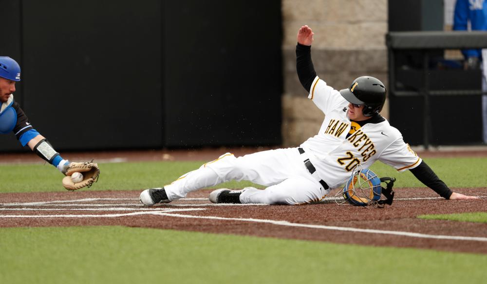 Iowa Hawkeyes catcher Austin Guzzo (20)