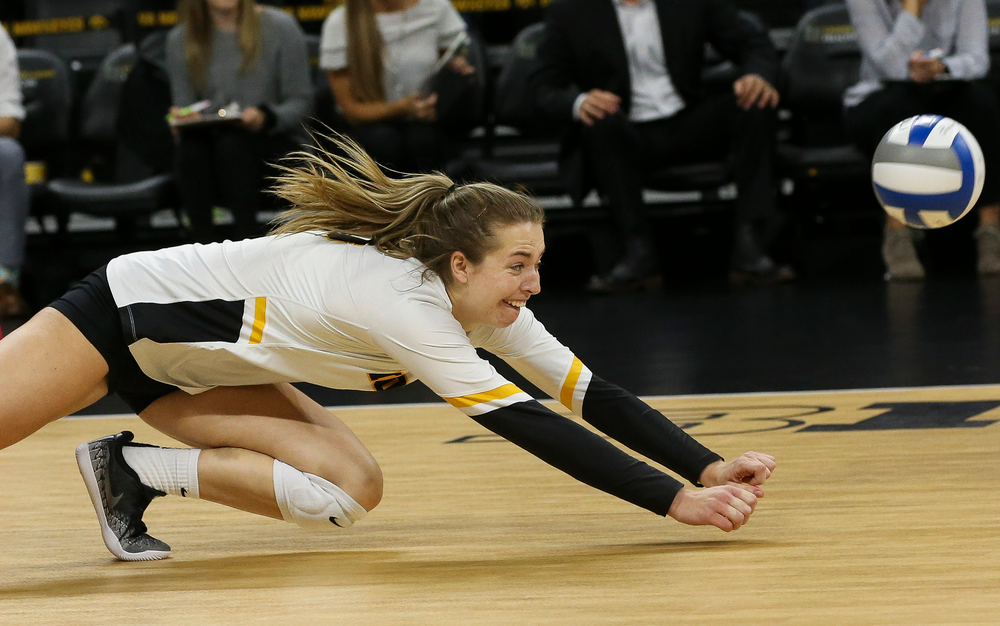 Iowa Hawkeyes outside hitter Meghan Buzzerio (5) dives for a dig during a game against Purdue at Carver-Hawkeye Arena on October 13, 2018. (Tork Mason/hawkeyesports.com)