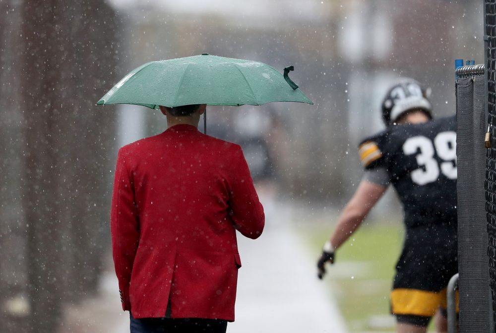 A Red Coat walks with the rain during practice Monday, December 23, 2019 at Mesa College in San Diego. (Brian Ray/hawkeyesports.com)