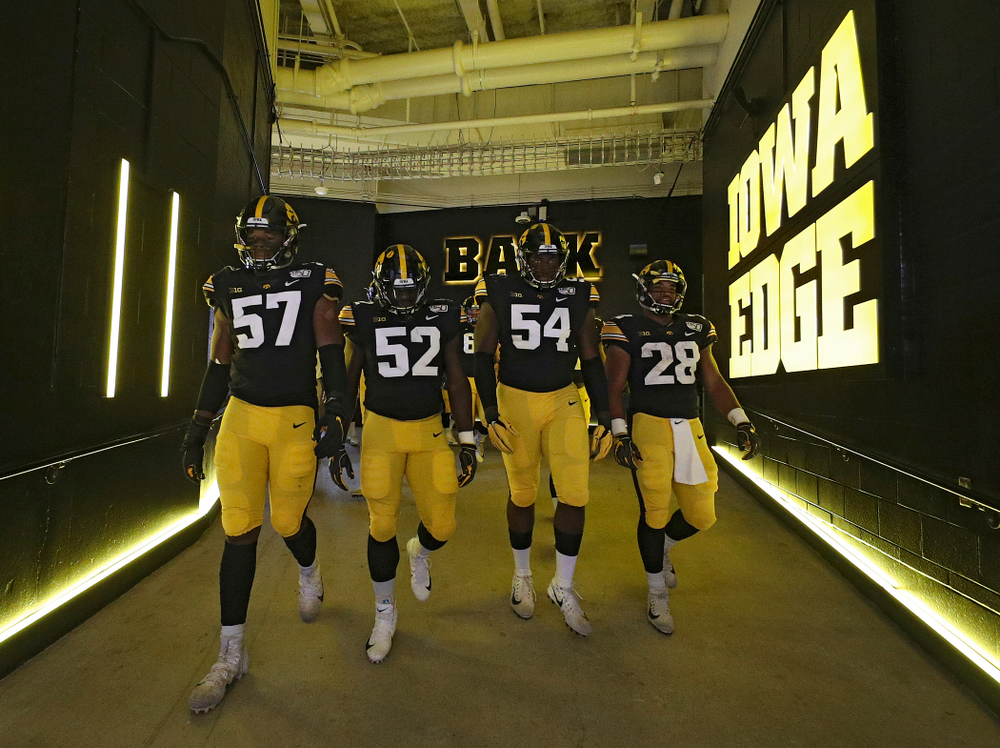 Iowa Hawkeyes defensive end Chauncey Golston (57), linebacker Amani Jones (52), defensive tackle Daviyon Nixon (54), and running back Toren Young (28) walk down the tunnel to take the field for the second half of their game at Kinnick Stadium in Iowa City on Saturday, Sep 28, 2019. (Stephen Mally/hawkeyesports.com)