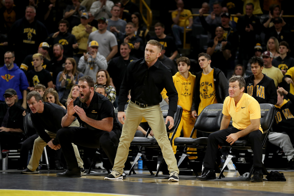 The Iowa Hawkeyes coaches as Alex Marinelli wrestles WisconsinÕs Evan Wick at 165 pounds Sunday, December 1, 2019 at Carver-Hawkeye Arena. Marinelli won the match 4-2. (Brian Ray/hawkeyesports.com)
